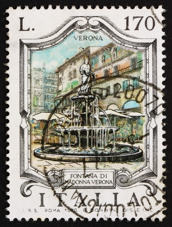 ITALY - CIRCA 1976: a stamp printed in the Italy shows Madonna Fountain, Verona, Italy, circa 1976 Stock Photo - 13182552