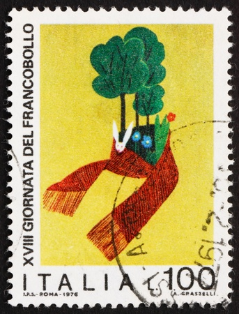 tree service pictures: ITALY - CIRCA 1976: a stamp printed in the Italy shows Trees, Rabbit and Flowers, Child Drawing, Nature Protection, circa 1976