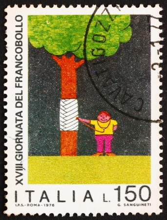 tree service pictures: ITALY - CIRCA 1976: a stamp printed in the Italy shows Boy Healing Tree, Child Drawing, Nature Protection, circa 1976