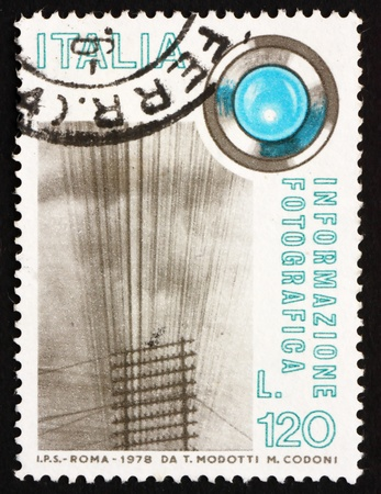 ITALY - CIRCA 1978: a stamp printed in the Italy shows Telegraph Wires and Lens, Photographic Information, circa 1978