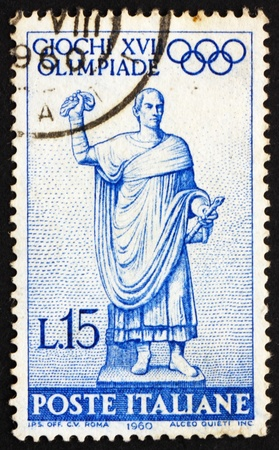 ITALY - CIRCA 1960: a stamp printed in the Italy shows Statue of Roman Consul on Way to the Games, 17th Olympic Games, Rome, circa 1960