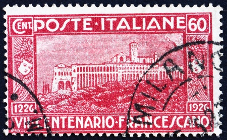 ITALY - CIRCA 1926: a stamp printed in the Italy shows View of Assisi Monastery, Italy, circa 1926 Stock Photo - 13257346