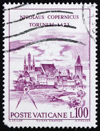 VATICAN - CIRCA 1973: a stamp printed in the Vatican shows View of Torun, Nicolaus Copernicus, Polish Astronomer, circa 1973 Stock Photo - 13257341