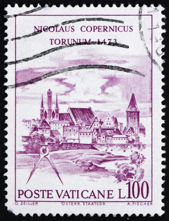 copernicus: VATICAN - CIRCA 1973: a stamp printed in the Vatican shows View of Torun, Nicolaus Copernicus, Polish Astronomer, circa 1973