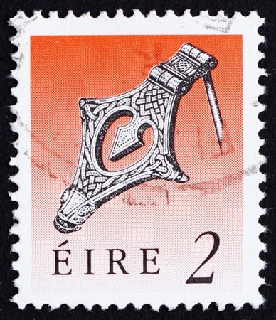 IRELAND - CIRCA 1990: a stamp printed in the Ireland shows Silver Kite Brooch, Viking Age, Art Treasure of Ireland, circa 1990