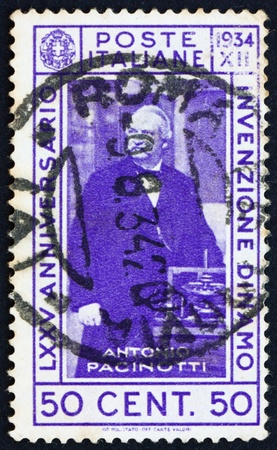 ITALY - CIRCA 1934: a stamp printed in the Italy shows Antonio Pacinotti, 75th Anniversary of Invention of the Dynamo by Pacinotti, circa 1934 Stock Photo - 13257343