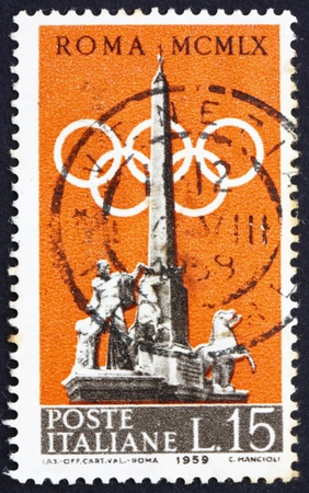 ITALY - CIRCA 1959: a stamp printed in the Italy shows Fountain of Dioscuri and Olympic Rings, 1960 Olympic Games in Rome, circa 1959