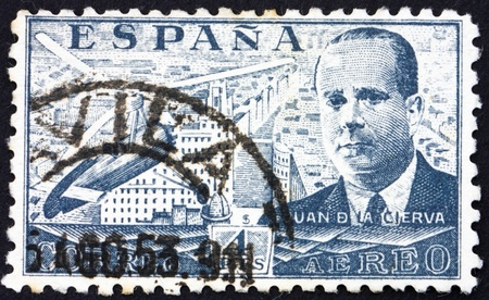 SPAIN - CIRCA 1941: a stamp printed in the Spain shows Juan de la Cierva and his Autogiro over Madrid, Inventor of the Autogiro, circa 1941 Stock Photo - 13257364