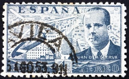 SPAIN - CIRCA 1941: a stamp printed in the Spain shows Juan de la Cierva and his Autogiro over Madrid, Inventor of the Autogiro, circa 1941 Stock Photo - 13257364