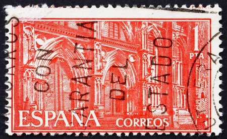 SPAIN - CIRCA 1959: a stamp printed in the Spain shows Monastery of Guadalupe, Portals, 50th Anniversary of Entrance of the Franciscan Brothers into Guadalupe Monastery, circa 1959 Stock Photo - 13257370