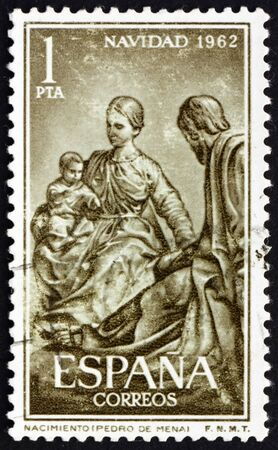 SPAIN - CIRCA 1962: a stamp printed in the Spain shows Holy Family by Pedro de Mena, Nativity, circa 1962