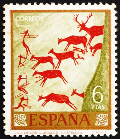 mesolithic: SPAIN - CIRCA 1962: a stamp printed in the Spain shows Hunters and Deer Herd, Wall Painting found in Spanish Cave, circa 1962
