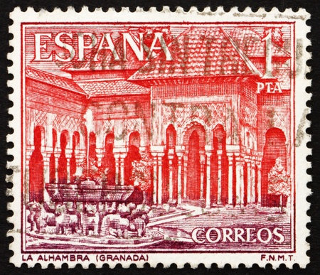 SPAIN - CIRCA 1964: a stamp printed in the Spain shows Court of Lions, Alhambra, Granada, Andalusia, Spain, circa 1964 Stock Photo - 13337238