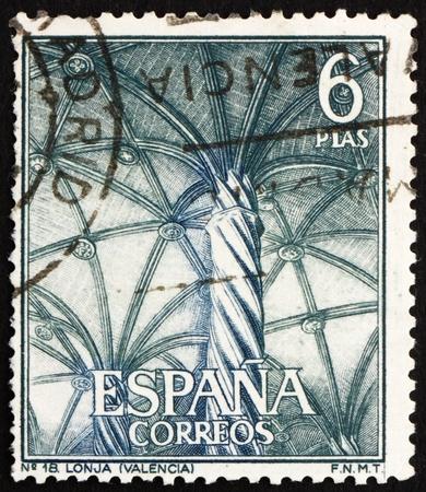commemorate: SPAIN - CIRCA 1965: a stamp printed in the Spain shows Interior of Silk Merchants' Hall, Lonja, Valencia, Spain, circa 1965