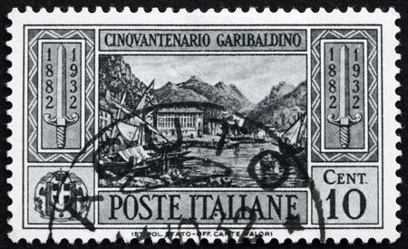 commemorate: ITALY - CIRCA 1932: a stamp printed in the Italy shows View of Caprera, 50th Anniversary of the Death of Giuseppe Garibaldi, Patriot, circa 1932 Editorial