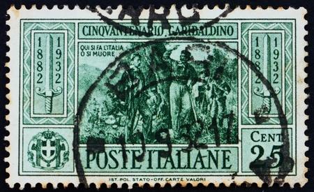 commemorate: ITALY - CIRCA 1932: a stamp printed in the Italy shows Garibaldi at Battle of Calatafimi, 50th Anniversary of the Death of Giuseppe Garibaldi, Patriot, circa 1932