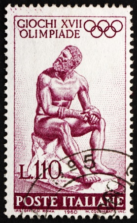 ITALY - CIRCA 1960: a stamp printed in the Italy shows Statue of Seated Boxer by Lysippus of Sikyon, 17th Olympic Games, Rome, circa 1960 Stock Photo - 13337823