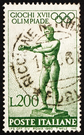 ITALY - CIRCA 1960: a stamp printed in the Italy shows Statue of Apoxyomenos by Lysippus of Sikyon, 17th Olympic Games, Rome, circa 1960