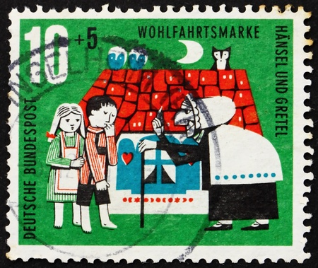 cancelled stamp: GERMANY - CIRCA 1961: a stamp printed in the Germany shows Hansel, Gretel and Witch, Scene from Hansel and Gretel, circa 1961