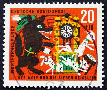 commemorate: GERMANY - CIRCA 1963: a stamp printed in the Germany shows The Wolf and the seven Kids, Scene from The Wolf and the seven kids, circa 1963