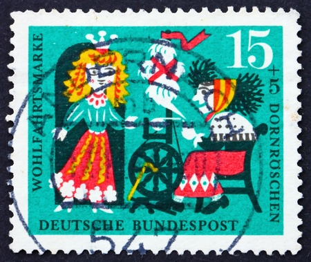 wicked problem: GERMANY - CIRCA 1964: a stamp printed in the Germany shows Princess and Wicked Fairy, Scene from Sleeping Beauty, circa 1964
