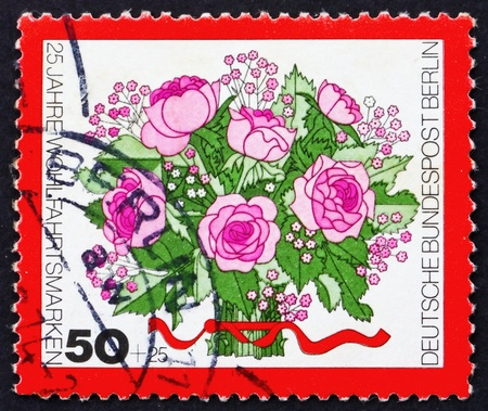 GERMANY - CIRCA 1974: a stamp printed in the Germany Berlin shows Bouquet of Rose Flowers, circa 1974