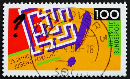 GERMANY - CIRCA 1990: a stamp printed in the Germany shows Labyrinth, 25th Anniversary of Youth Science and Technology Competition, circa 1990 Stock Photo - 13365163