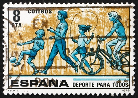 SPAIN - CIRCA 1979: a stamp printed in the Spain shows Children kicking Ball and Skipping Rope, Jogging, and Bicycling, Sport for All, circa 1979