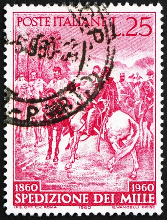 ITALY - CIRCA 1960: a stamp printed in the Italy shows Garibaldi meeting King Victor Emmanuel II at Teano, Centenary of the Liberation of Southern Italy, circa 1960