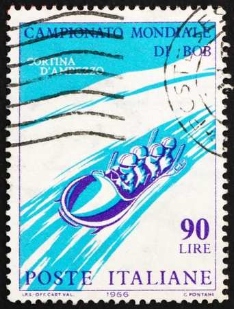bobsled: ITALY - CIRCA 1966: a stamp printed in the Italy shows Four-Man Bobsled, International Bobsled Championships Cortina d�Ampezzo, circa 1966 Editorial