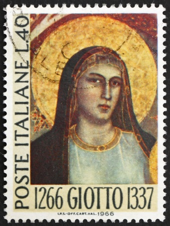 ITALY - CIRCA 1966: a stamp printed in the Italy shows Madonna, by Giotto, 700th Anniversary of the Birth of Giotto di Bondone, Florentine Painter, circa 1966 Stock Photo - 13512294