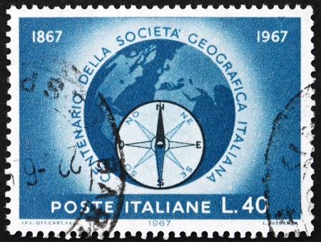 ITALY - CIRCA 1967: a stamp printed in the Italy shows Globe and Compass Rose, Centenary of Italian Geographical Society, circa 1967