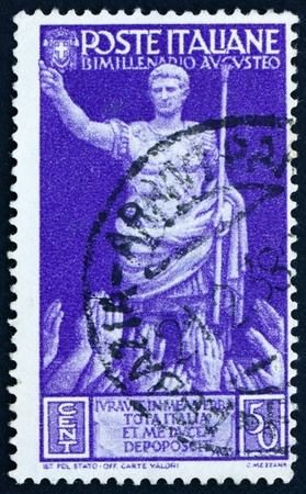 and acclaim: ITALY - CIRCA 1937: a stamp printed in the Italy shows Emperor Augustus Caesar Octavianus Receiving Acclaim, 2000th Anniversary of the Birth of Augustus, circa 1937