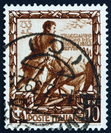 proclamation: ITALY - CIRCA 1938: a stamp printed in the Italy shows Romulus Plowing a Furrow to Mark the Boundary of New City Rome, Proclamation of Italian Empire, circa 1938 Editorial