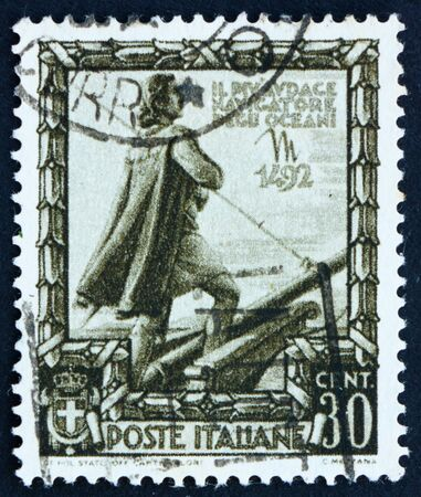 ITALY - CIRCA 1938: a stamp printed in the Italy shows Christopher Columbus, Cristobal Colon, Explorer, Colonizer, Navigator, Proclamation of Italian Empire, circa 1938
