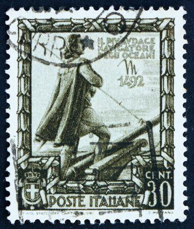 colonizer: ITALY - CIRCA 1938: a stamp printed in the Italy shows Christopher Columbus, Cristobal Colon, Explorer, Colonizer, Navigator, Proclamation of Italian Empire, circa 1938