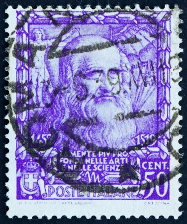 ITALY - CIRCA 1938: a stamp printed in the Italy shows Leonardo da Vinci, inventor, scientist, Proclamation of Italian Empire, circa 1938 Stock Photo - 13626880