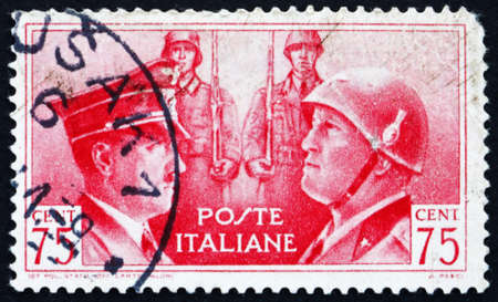 adolf hitler: ITALY - CIRCA 1941: a stamp printed in the Italy shows Adolf Hitler and Benito Mussolini, Rome-Berlin Axis, circa 1941 Editorial