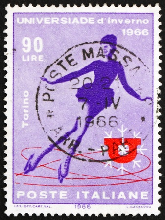 ITALY - CIRCA 1966: a stamp printed in the Italy shows Woman Skater, Winter University Games, Torino, circa 1966