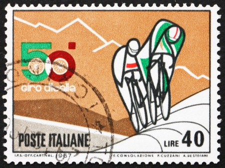 ITALY - CIRCA 1967: a stamp printed in the Italy shows Bicyclists and Mountains, 50th Bicycle Tour of Italy, The Giro, circa 1967