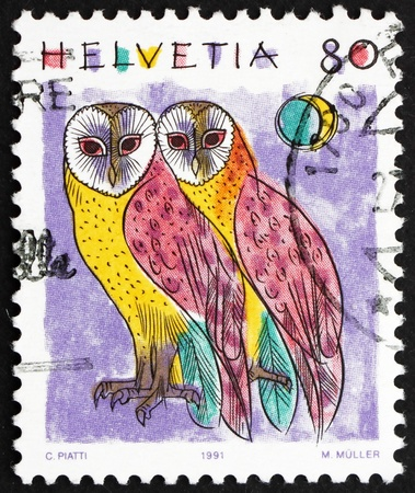SWITZERLAND - CIRCA 1991: a stamp printed in the Switzerland shows Common Barn Owls, Tyto Alba, Animal, circa 1991