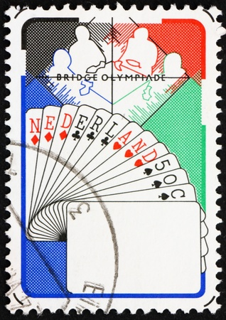 olympiad: NETHERLANDS - CIRCA 1980: a stamp printed in the Netherlands shows Bridge Players, Netherlands Hand, 6th Bridge Olympiad, Valkenburg, circa 1980