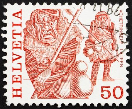 SWITZERLAND - CIRCA 1977: a stamp printed in the Switzerland shows Masked Men, Achetringelen Laupen, Bern, Folk Customs, circa 1977 Stock Photo - 13685505