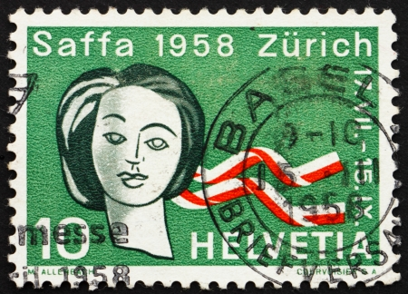 SWITZERLAND - CIRCA 1958: a stamp printed in the Switzerland shows Woman's Head and Ribbons in Swiss Colors, Saffa Exhibition, Zurich, Women's Suffrage, circa 1958