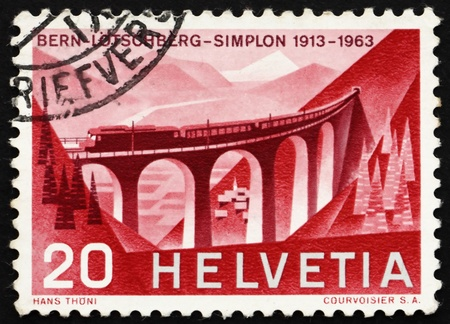 SWITZERLAND - CIRCA 1963: a stamp printed in the Switzerland shows Luegelkinn Viaduct, 50th Anniversary of Lotschberg Railroad, circa 1963