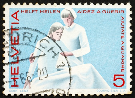 SWITZERLAND - CIRCA 1965: a stamp printed in the Switzerland shows Nurse and Patient, Medical Profession, circa 1965