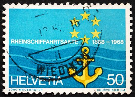 SWITZERLAND - CIRCA 1968: a stamp printed in the Switzerland shows Flag of Rhine Navigation Committee, Centenary of the Rhine Navigation Act, circa 1968 Stock Photo - 13685504