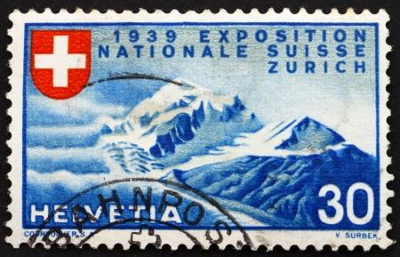 ZWITSERLAND - CIRCA 1939: een stempel gedrukt in het Zwitserland toont Alpenlandschap, de Nationale Tentoonstelling van 1939, Zürich, circa 1939