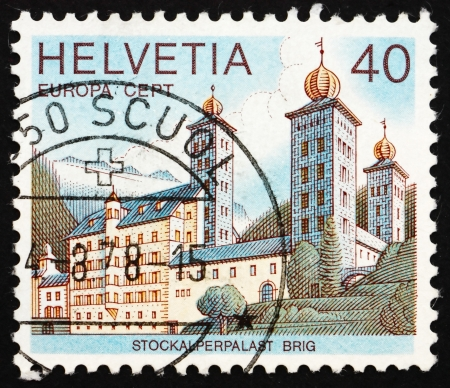 SWITZERLAND - CIRCA 1978: a stamp printed in the Switzerland shows Stockalper Palace, Brig, Switzerland, circa 1978 Stock Photo - 13685501