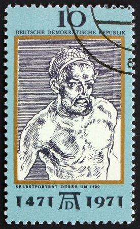 durer: DDR - CIRCA 1971: a stamp printed in DDR shows Self-Portrait, by Durer, 500th anniversary of the birth of Albrecht Durer, painter and engraver, circa 1971